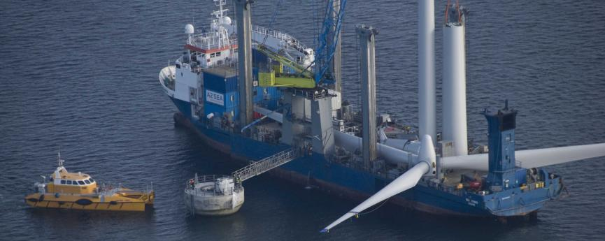 Boat carrying disassembled wind turbine